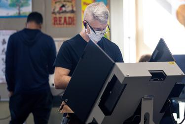 People vote at Audelia Road Branch Library on the first day of early voting in Dallas on Oct. 13, 2020.
