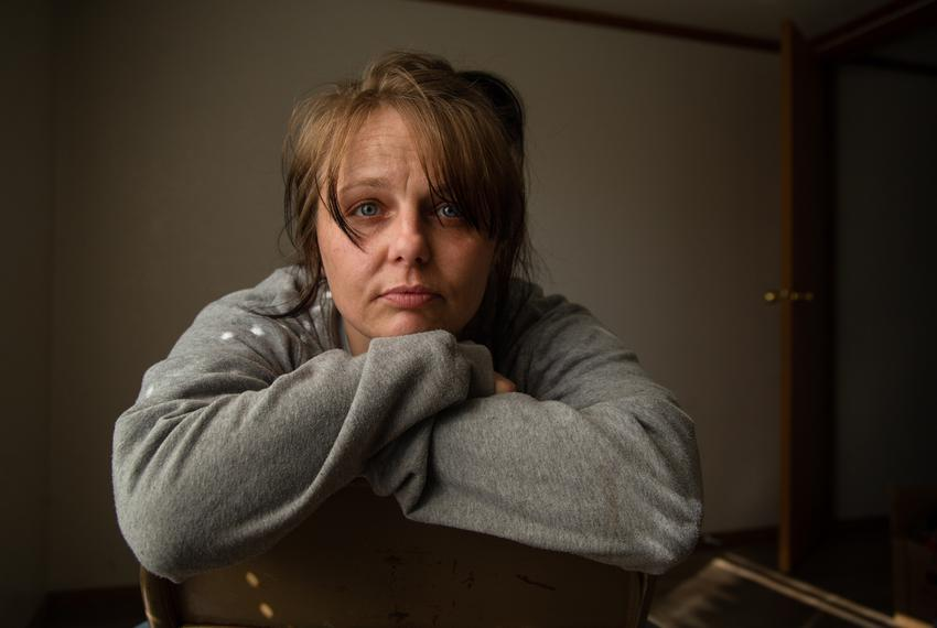 Wendy Bryant poses for a portrait inside her new mobile home in Del Leon, on March 25, 2021.  It has been almost a year sinc…