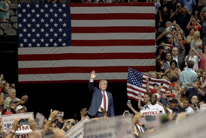 Presidential contender Donald Trump enters the rally at the American Airlines Center in Dallas on Sept. 14, 2015.