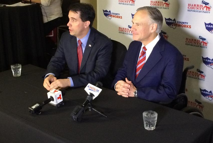 Wisconsin Gov. Scott Walker (left) and Texas Gov. Greg Abbott (right) hold a news conference Saturday in Houston. Abbott a...