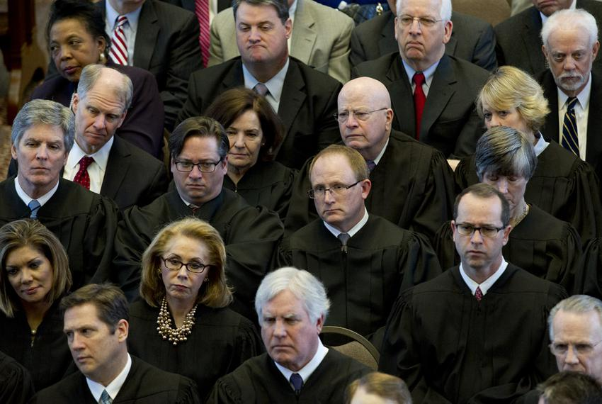 Texas Supreme Court and Court of Criminal Appeals justices listen to Chief Justice Nathan Hecht's State of the Judiciary spe…