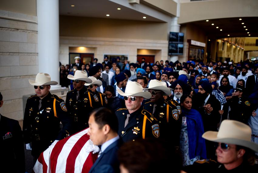 Thousands honor Harris County Deputy Sandeep Dhaliwal at his funeral at the Berry Center in Houston. The law enforcement cer…