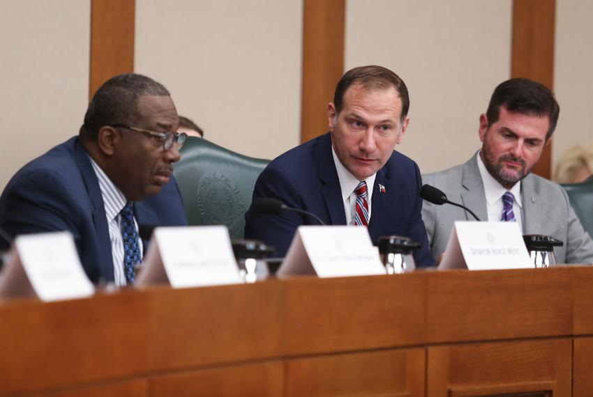 State Sen. Charles Schwertner, R-Georgetown (center), listens to testimony at a hearing held by the Senate Select Committee …