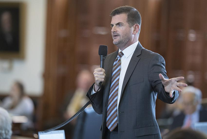 State Sen. Brandon Creighton, R-Conroe, explains parts of House BIll 214 to Sen. José Menéndez, D-San Antonio, on August 12,…