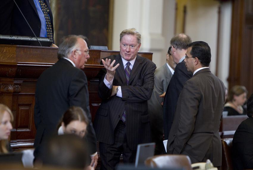 Rep. Jim Pitts, R-Waxahachie speaks with Rep. Todd Hunter R-Corpus Christi and Rep. Abel Herrero D-Robstown on House floor b…