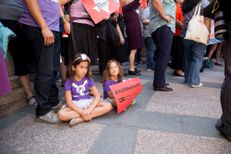 Libby Gonzales, a 7-year-old transgender girl,and her sister sit by their parents at a press conference in the Capitol rotunda concerning SB 3 and SB 91 on July 21, 2017.