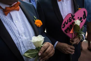 Many couples brought flowers and signs with them to the ceremony.