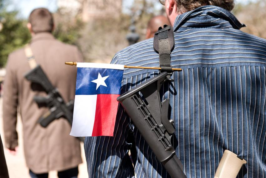 Gun rights supporters participate in an open carry march during South by Southwest led by the Austin chapter of Come and Tak…