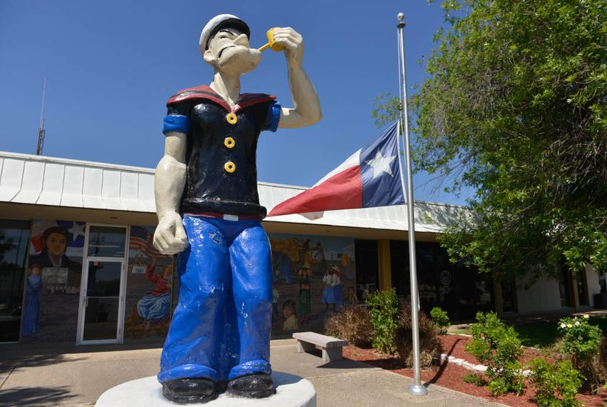 A statue of Popeye the Sailor stands at the front of the Crystal City City Hall. The struggling South Texas town calls itsel…