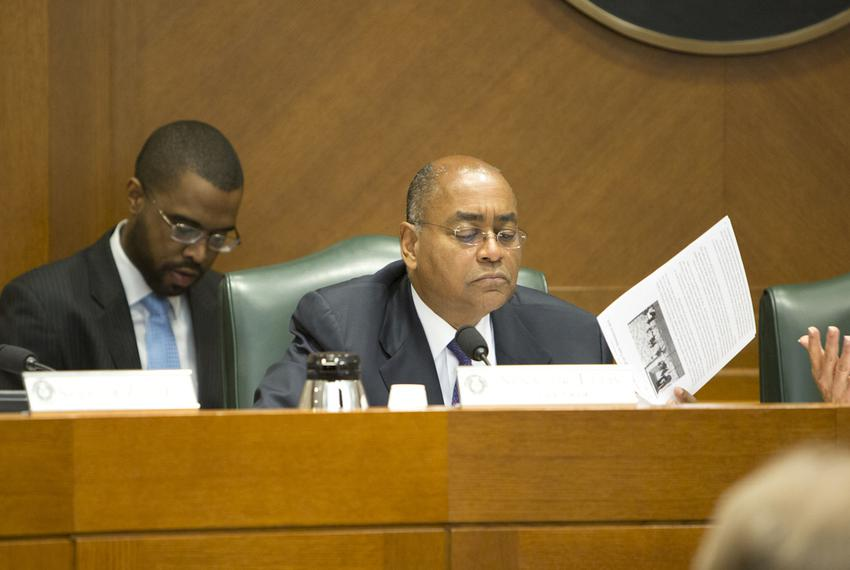 Sen. Rodney Ellis D-Houston reads information during the Senate Committee on State Affairs as they listen to testimony rel...