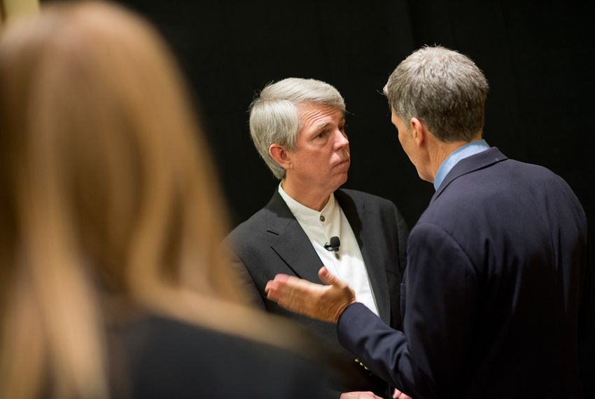 David Barton, left, of WallBuilders talks with a delegate as he poses for photos at a Texas Eagle Forum reception at the Texas Republican Convention in Fort Worth on June 7, 2012.