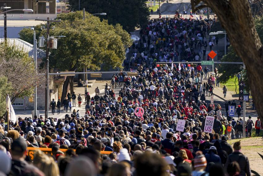 Crowds march through Austin in celebration of Martin Luther King Day on Jan. 20, 2020.