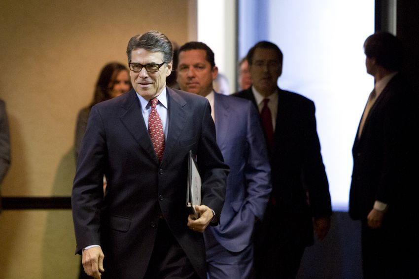 Gov. Rick Perry walks into a press conference with his legal team on Jan. 28, 2015.