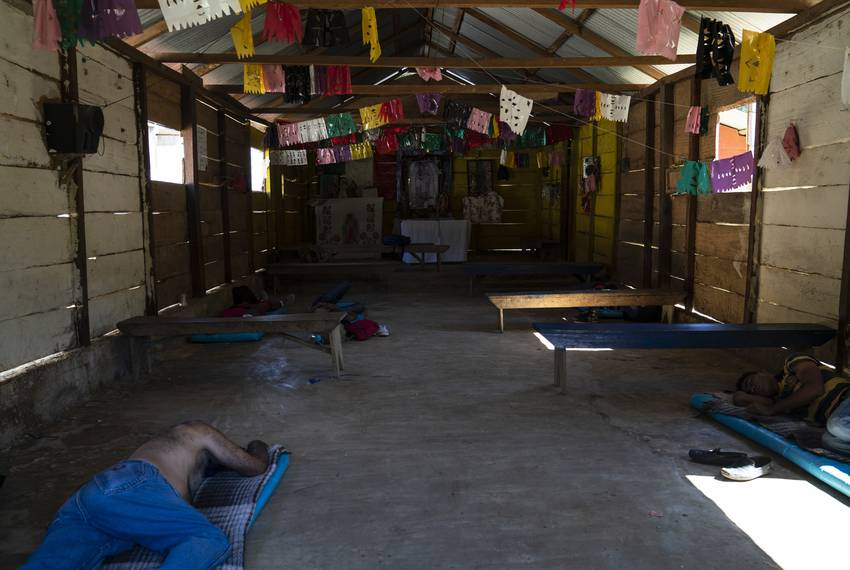 "Honduran migrants Juan Ramón Andino, 60, left, and José, 40, right, sleep in a church that also serves as a migrant shelter in the community General Emiliano Zapata del Valle near Palenque, Chiapas on Oct. 24. The shelter is located along Highway 307 known as ""El gran corredor del pacífico del migrante,"" or ""The Great Pacific Corridor of the Migrant."" This is a common route for Honduran migrants due to its proximity to their country."