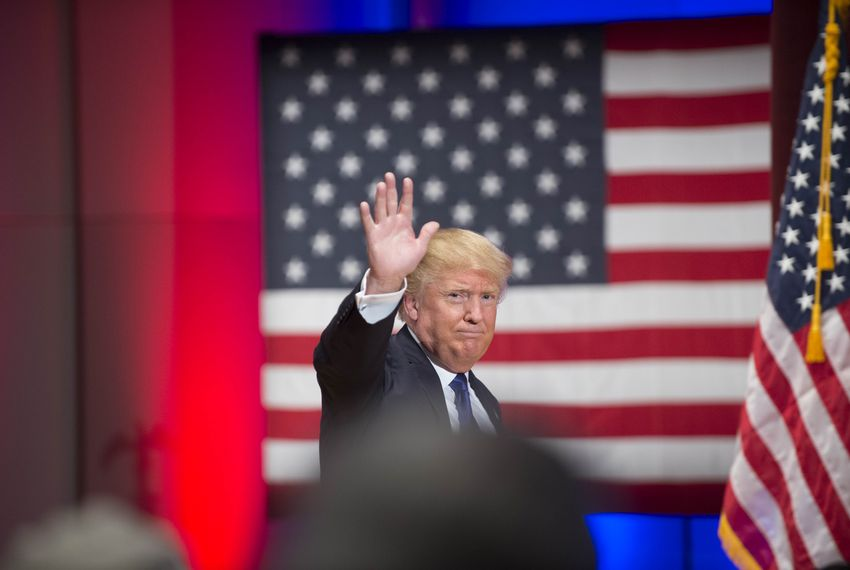 Donald Trump rallies a crowd of veterans at Drake University on Jan. 28, 2016, while other Republican presidential candidates hold a final Des Moines debate prior to the Iowa caucuses.