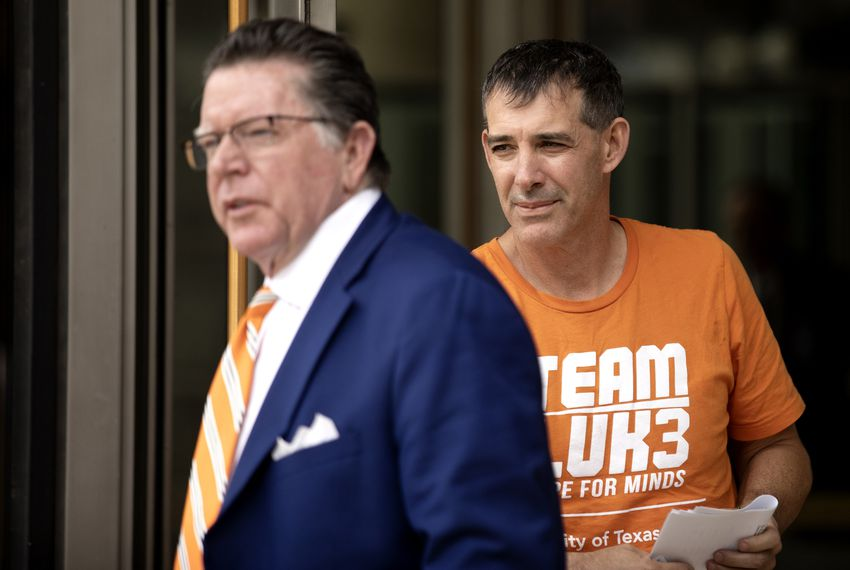 UT men's tennis coach Michael Center exited the federal courthouse in Austin on Tuesday. The university fired him on Wednesday after FBI documents revealed that he allegedly accepted a $100,000 bribe in 2015 to help with a student'­s admission.