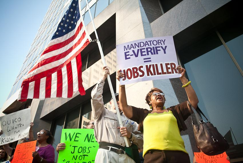 Protesters march to the site of the fundraiser with Speaker John Boehner and several Texas congressmen.