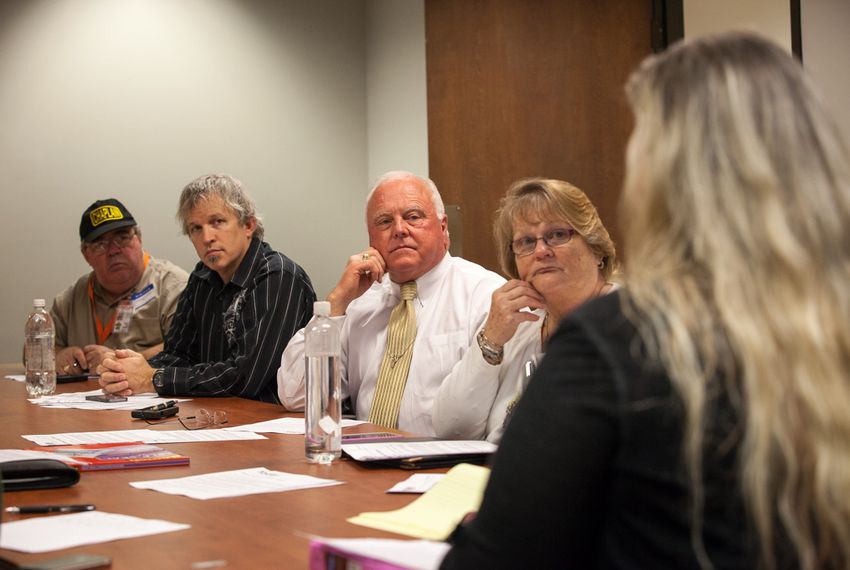 "Texas Agriculture Commissioner Sid Miller looks on during a lunchtime ""Faith at Work"" session at the Stephen F. Austin state office building. Such weekly meetings are organized by Michael Tummillo, who Miller named the official volunteer chaplain at the Department of Agriculture."