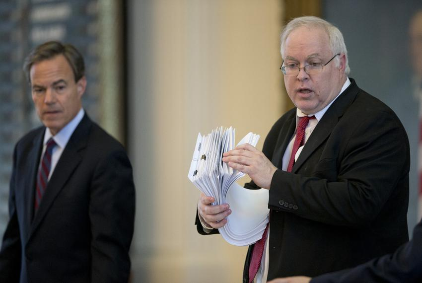 House Parliamentarian Chris Griesel is handed another stack of bills during debate on S.B. 19 Tuesday evening May 26, 2015...