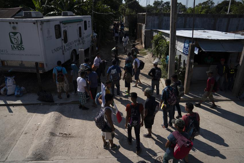 More than 50 migrants, all Honduran with the exception of one Guatemalan, walk to the nearest train station on Oct. 26, 2018…