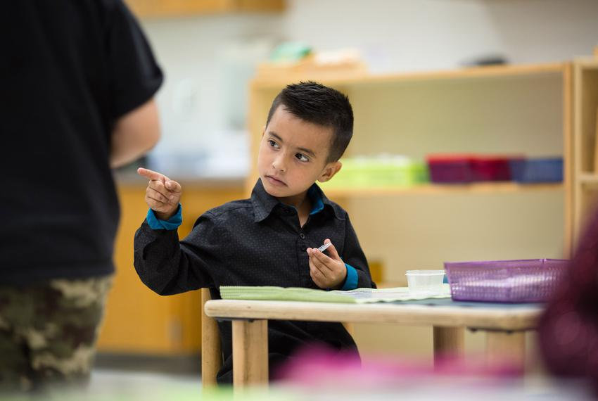 Class ambassador Dilan Almonacio uses hand gestures to communicate at East Texas Montessori Prep Academy.