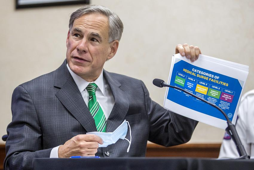 Gov. Greg Abbott speaks about the categories of medical surge facilities during a press conference at the Texas Department...