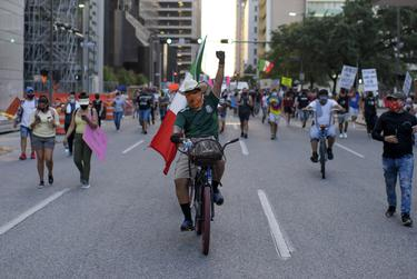 Hundreds of protesters marched through downtown Houston during a protest over the death of Vanessa Guillen. Guillen was a Houston-native who went missing from Fort Hood in April and is presumed to have been murdered by a fellow soldier. July 4, 2020.