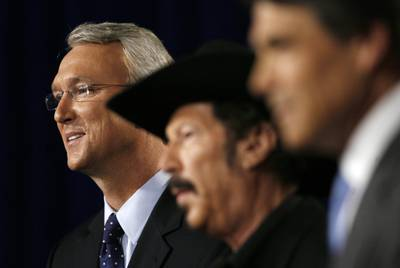 From left: 2006 Democratic gubernatorial candidate Chris Bell, independent candidate Kinky Friedman and Gov. Rick Perry participate in a debate in Dallas.