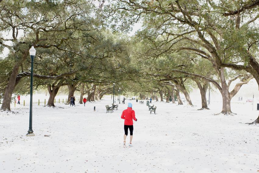 A jogger runs in Hermann Park in Houston on Feb. 15, 2021.