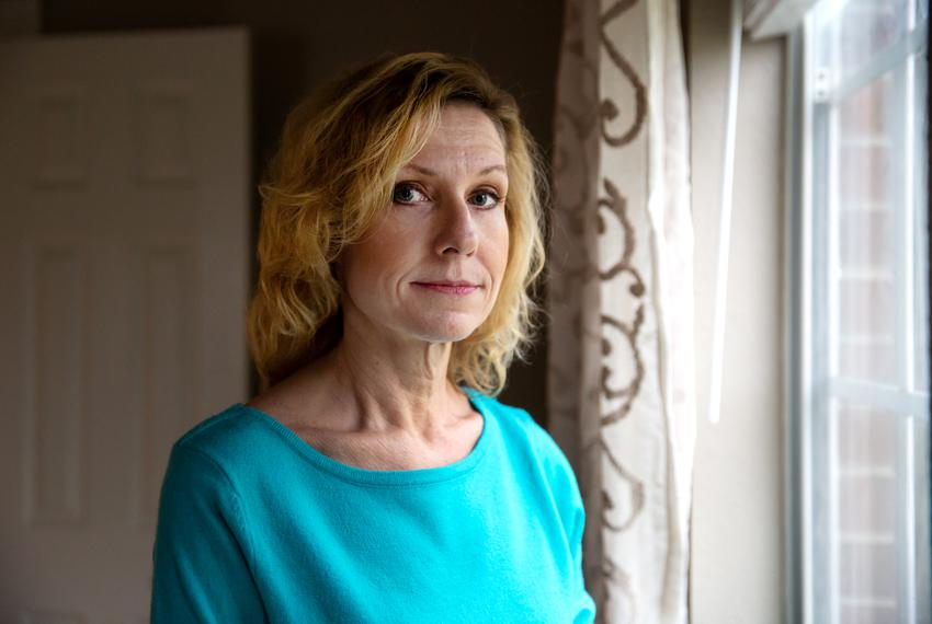 Flo Rice, 56, poses for a portrait in her home in Santa Fe, TX. Rice was shot in her legs at a school shooting in Santa Fe...