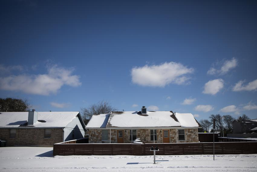 Snow of the roof of houses in South Austin after a massive snowstorm hit the state. Feb. 16, 2021.