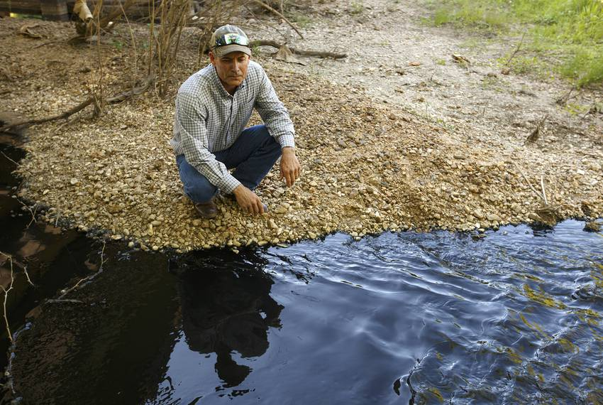 Colorado County Groundwater Conservation District board member Andrew Labay, who is also a fisheries biologist, near pollu...