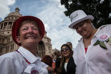 Kristin Taber and Pamela Holwerda, who travelled to Austin from Bell County, are pictured moments after being legally married on the south lawn of the Texas State Capitol in Austin on July 4, 2015. Taber and Holwerda have been together for 21 years.