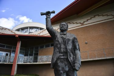 A sculpture of a lawmaker stands as part of the Juneteenth Memorial at George Washington Carver Museum, Cultural and Genealogy Center Tuesday in Austin. The memorial features five sculptures of a lawmaker, preacher, former slaves and their daughter, which represents the journey of the news about the emancipation of formerly enslaved black Texans. June 16, 2020.