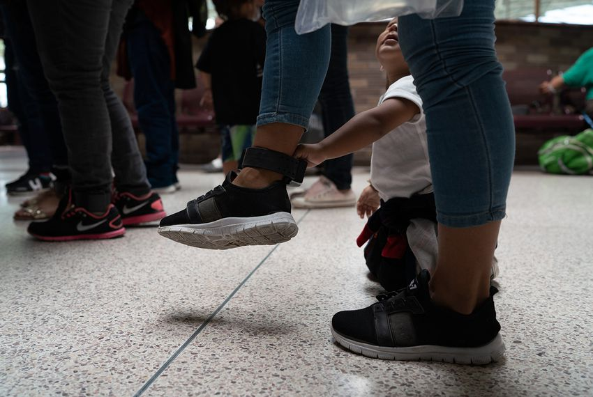 Central American asylum seekers wait at the bus station in McAllen to be taken to the Catholic Charities Humanitarian Respite Center on August 2, 2018.