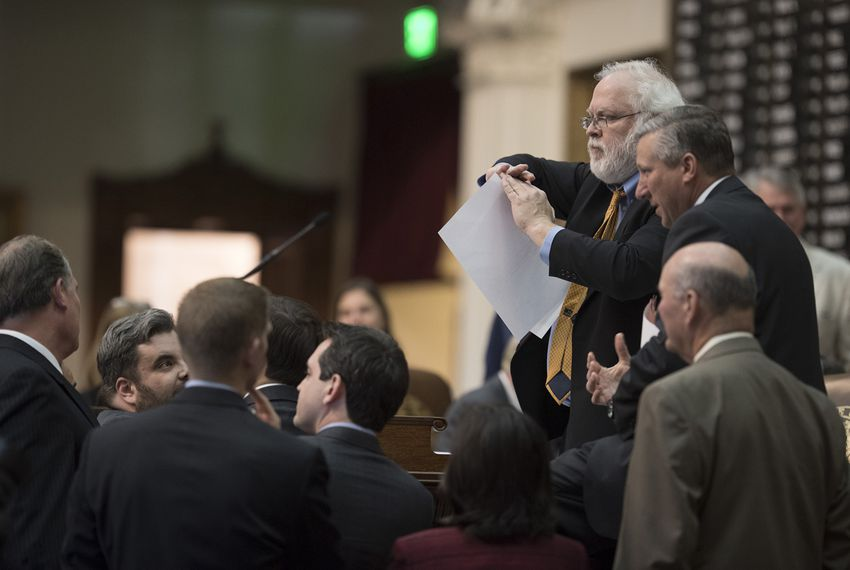 During a marathon debate on the state budget, Texas House Parliamentarian Chris Griesel reacts to a point of order on an amendment involving feral hog elimination.