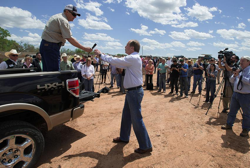 Lt. Gov. David Dewhurst accepted the microphone from Texas landowner Tommy Henderson on April 28, 2014, during a gathering o…