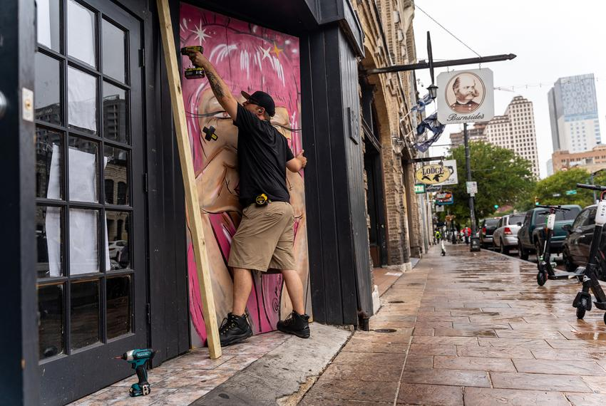 Workers boarded up bars on Sixth Street in Austin after Gov. Greg Abbott closed bars in Texas for the second time in three...