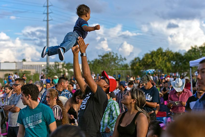 Terry Garcia plays with his son, Eli, 1, at the Festival Viva Mexico 2013 on Sunday, Sept. 8, 2013, in advance of Mexican Independence Day at a former greyhound racetrack in Corpus Christi.