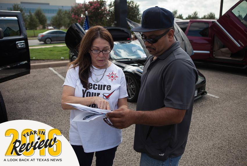 Jill Ramirez, the director of outreach for the Latino Healthcare Forum, passes out flyers and explains components of the A...