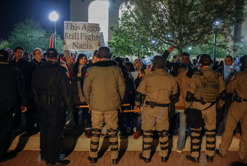 State Troopers in riot gear pushed protesters away from the building where white nationalist Richard Spencer was speaking at Texas A&M in 2016.