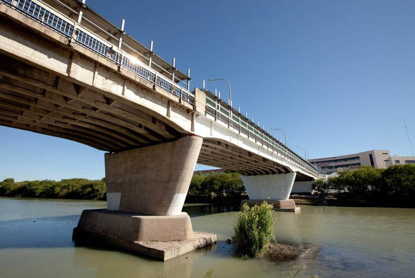 International Bridge No. 1 over the Rio Grande looking at Nuevo Laredo, Mexico, from the banks of a city park in Laredo. The…