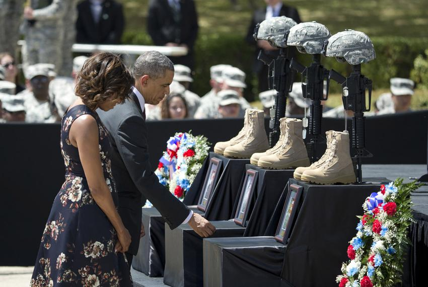 President Barack Obama and First Lady Michelle Obama pay respects to soldiers killed during a Fort Hood ceremony on April 9,…