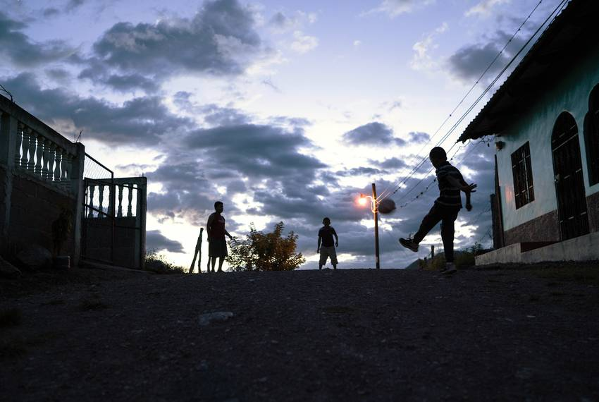 Children play near Carlos\u0027 family home in Olancho, Honduras.