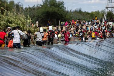 Migrants cross the Rio Grande between Del Rio, Texas and Ciudad Acuña, Mexico on Sept. 16, 2021.