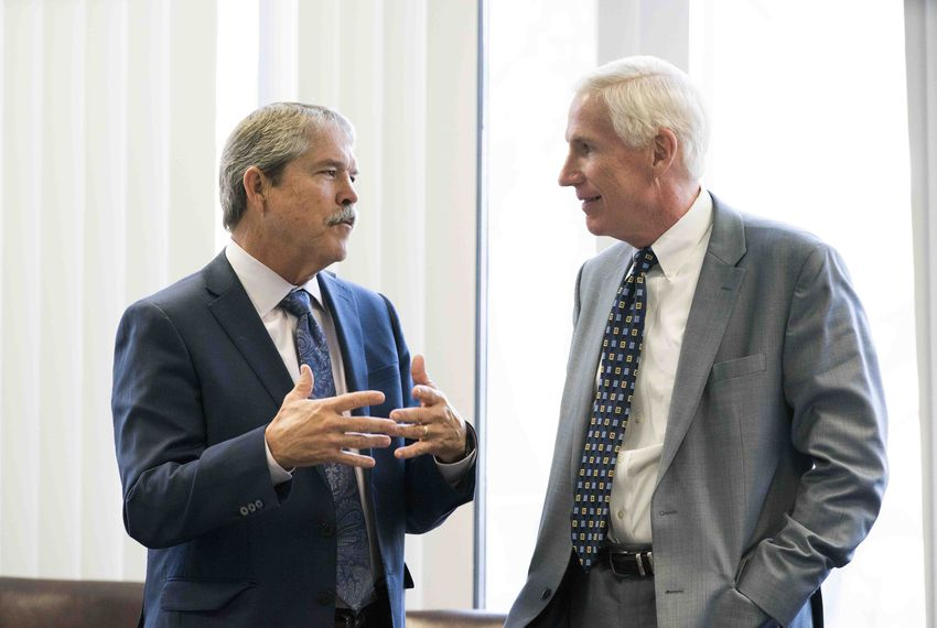 State Sen. Larry Taylor, R-Friendswood, (l), chats with Justice Scott Brister at the Texas Commission on School Finance meeting on Jan. 23, 2018.