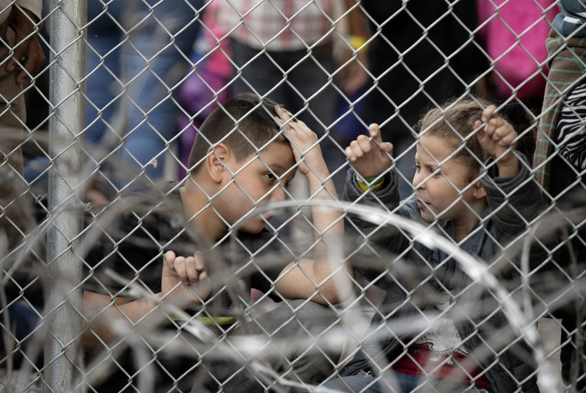 Two young children are seen inside a temporary migrant holding area setup by CBP under the Paso del Norte International port of entry between Ciudad Juárez and El Paso on March 27, 2019.