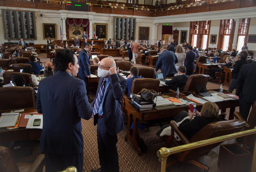 State Representitives work during session on the House floor at the state capitol on May 12, 2021.