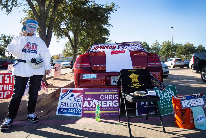 There was no shortage of candidate signs outside the Carrollton Public Library on the first day of early voting in Carrollto…