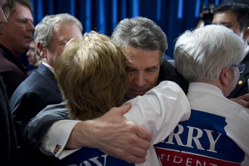 Rick Perry hugs a campaign worker after announcing he's headed back to Texas to reassess his campaign after finishing fifth …